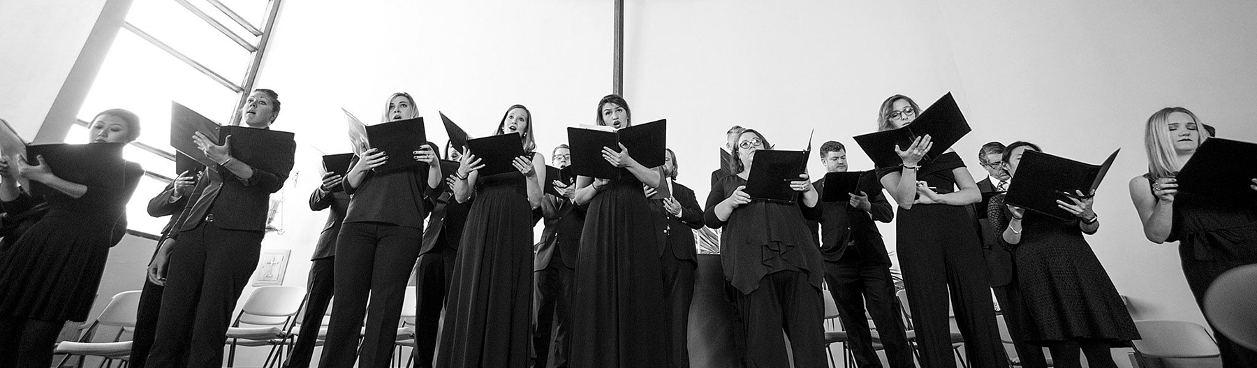 Black and white image of choral singers in church